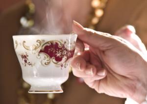 Hand holding a teacup